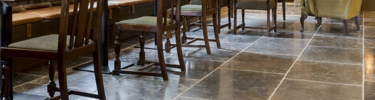 Choose a darker shade of floor tile for a warmer space
