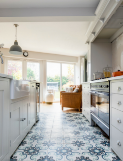 Porcelain tile feature in a kitchen, using a rug formation