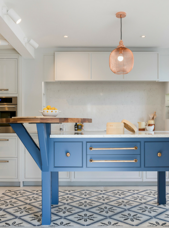 Bright blue kitchen island by Burlanes Interiors
