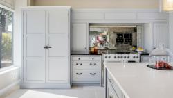 Burlanes Interiors bespoke kitchen design with limestone flooring